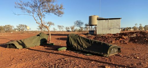 2 swags camped in Australian outback