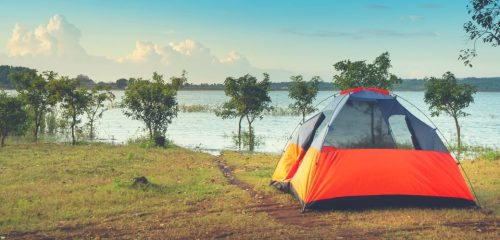 3 person tent camped by lake