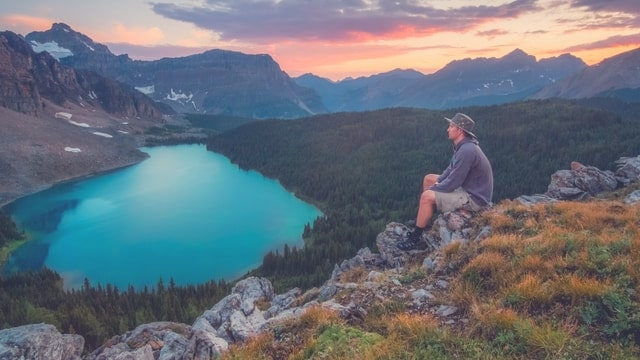 Relaxed hiker on mountain top