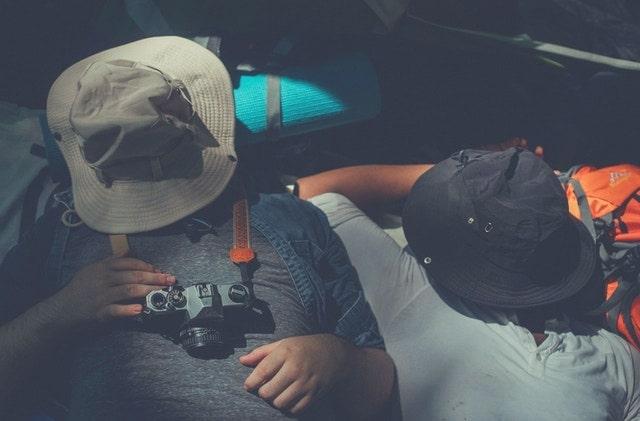 2 people sleeping in tent