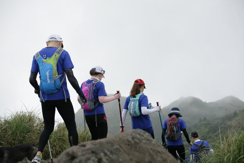 Group hiking with poles